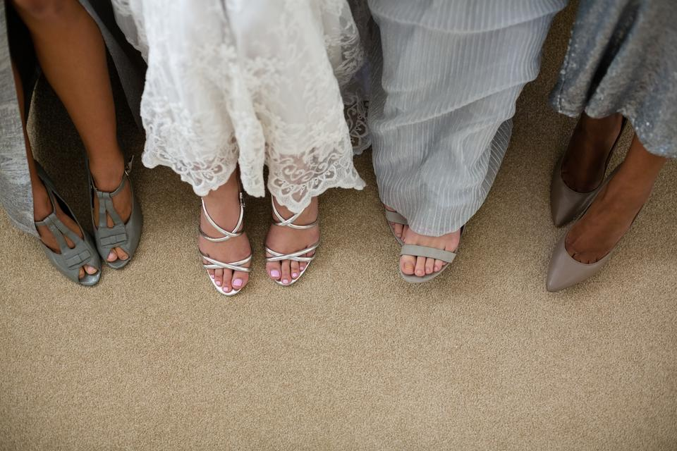 """""""Low section of bride and bridesmaids"""" stock image"""