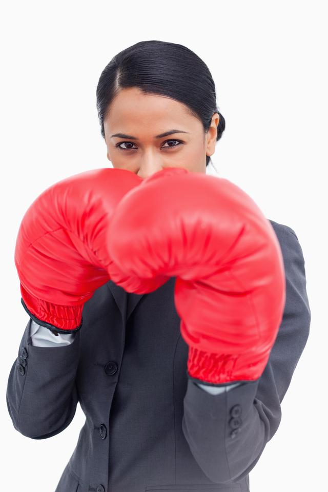 """""""Close up of belligerent saleswoman with boxing gloves"""" stock image"""