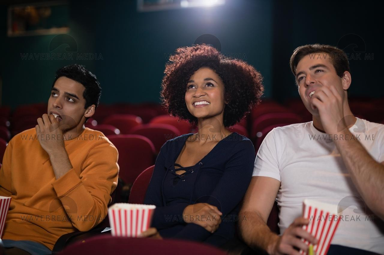 Group of people watching movie - License, download or print for £12.40 |  Photos | Picfair