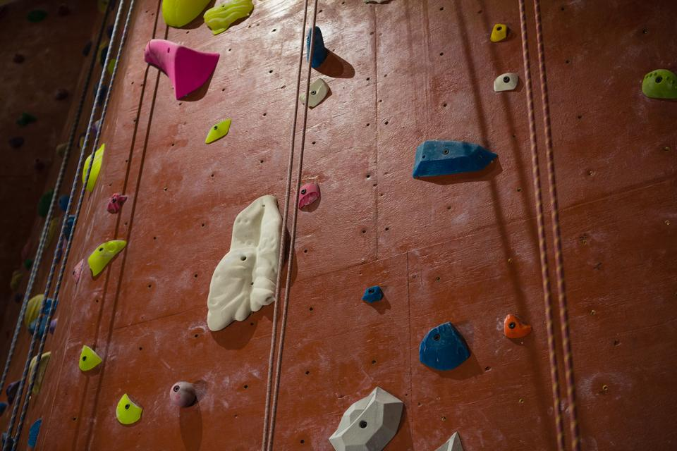 """""""Rope hanging by climbing wall at health club"""" stock image"""