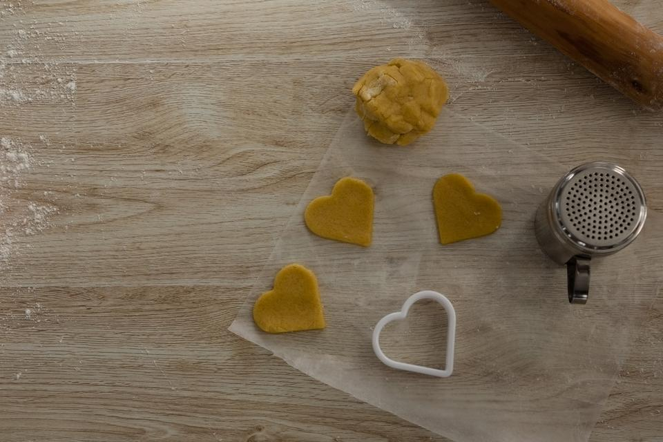 """""""Raw cookie dough with heart shaped cookie cutter and flour shaker strainer"""" stock image"""