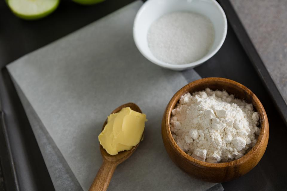 """""""Bowl of sugar and flour with butter in spoon"""" stock image"""