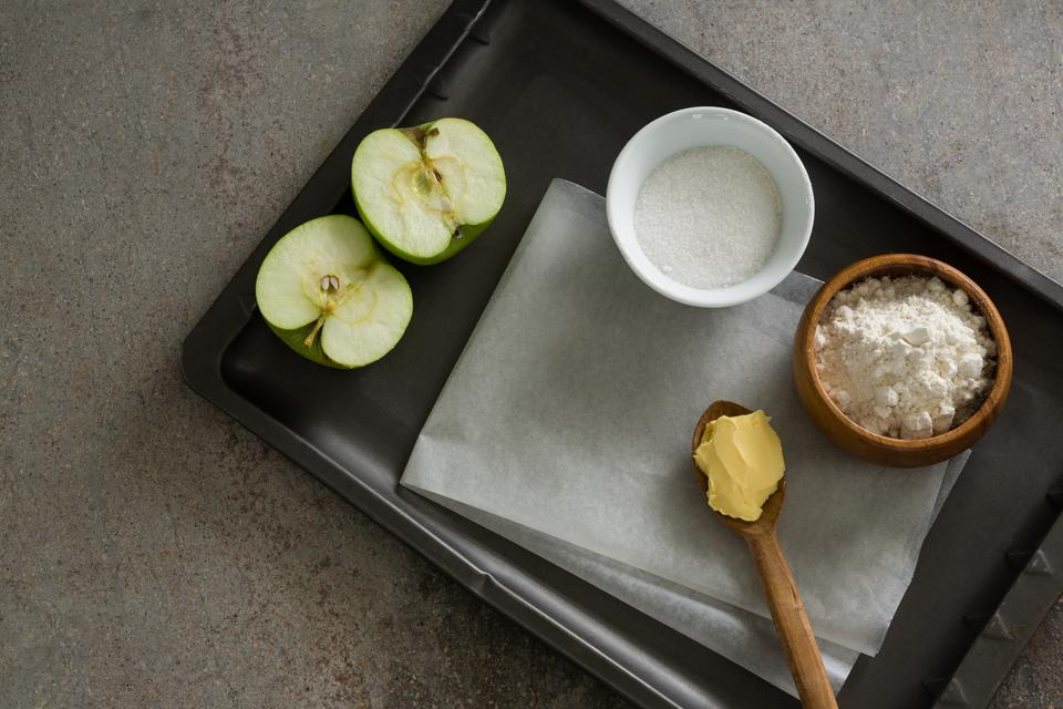 """""""Bowl of sugar and apple, flour with butter in spoon"""" stock image"""