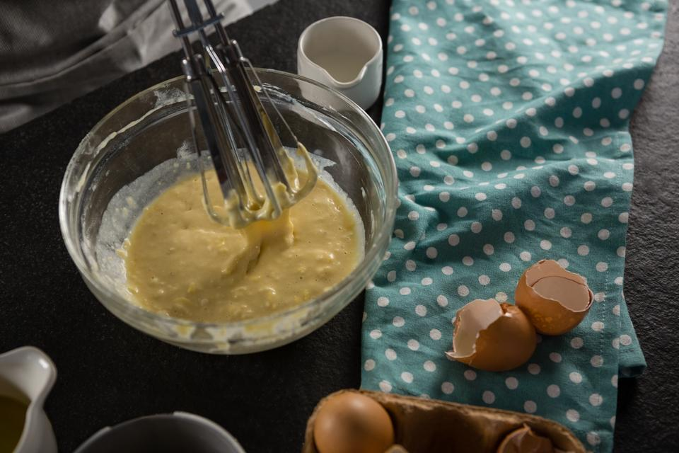 """Freshly whisked batter of beaten eggs, milk and butter in a bowl"" stock image"