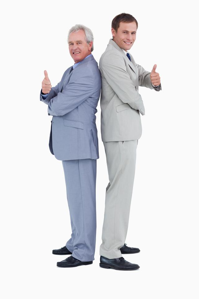 """""""Tradesmen standing back-to-back giving thumbs up"""" stock image"""