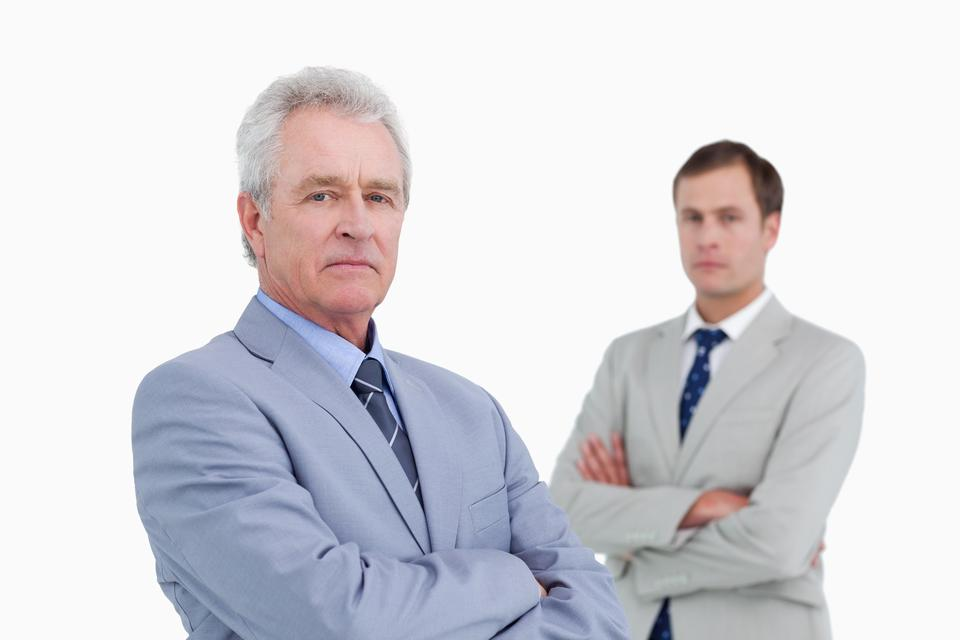 """""""Serious tradesmen with arms folded"""" stock image"""
