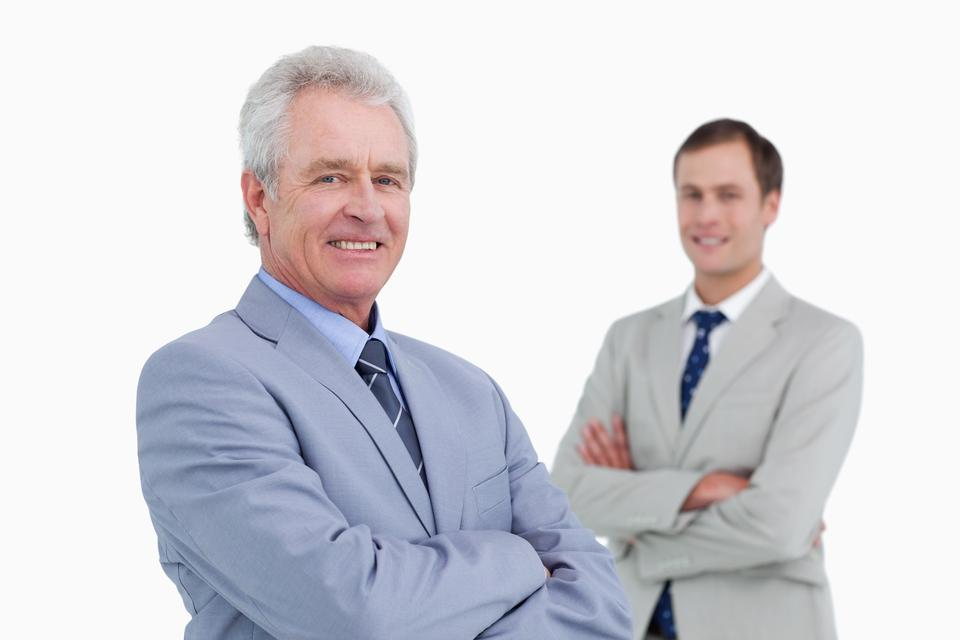 """""""Smiling tradesmen with arms folded"""" stock image"""