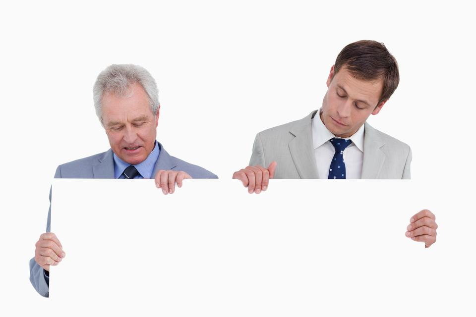 """""""Tradesmen looking at blank sign in their hands"""" stock image"""