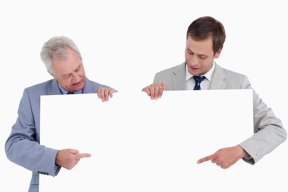 """""""Tradesmen pointing at blank sign in their hands"""" stock image"""