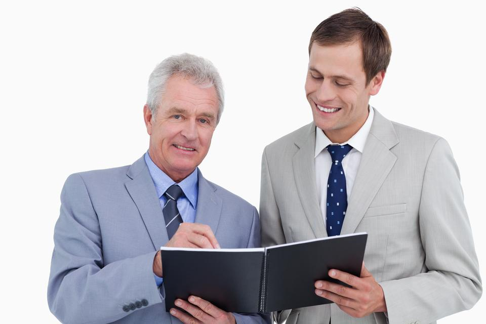 """""""Smiling tradesmen with notebook and pen"""" stock image"""