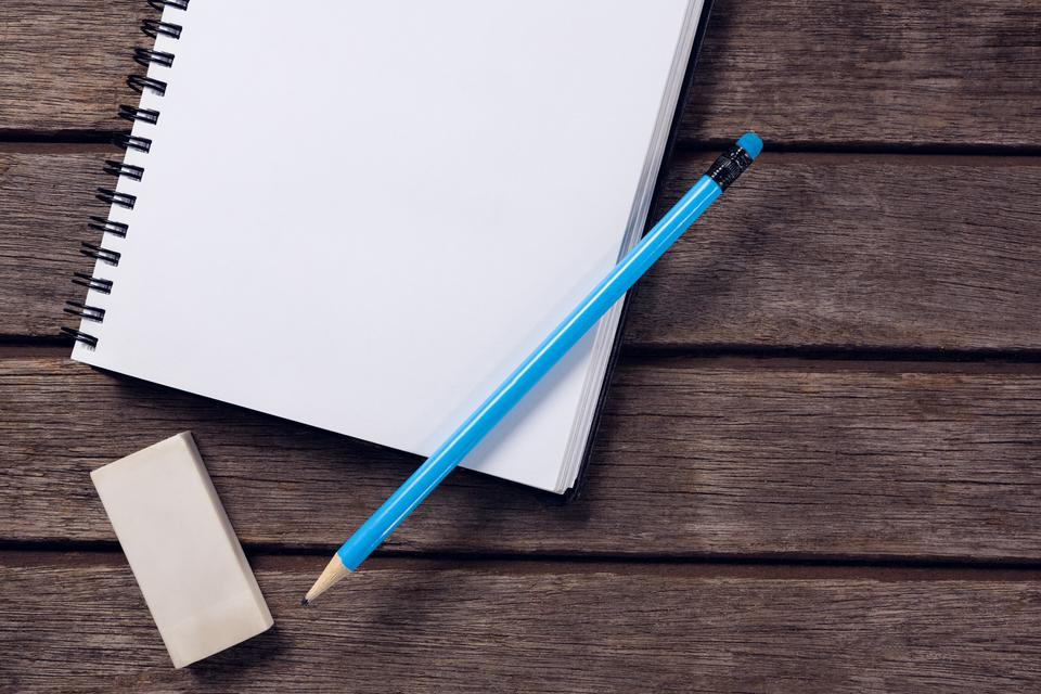 """""""Overhead of pencil and eraser on open diary"""" stock image"""