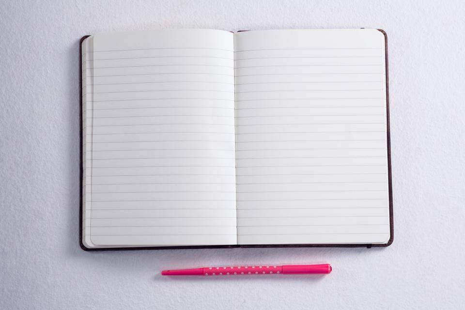 """Overhead of pen and open diary"" stock image"