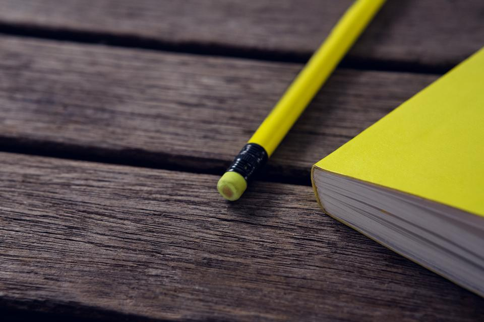 """Close-up of diary and pencil"" stock image"