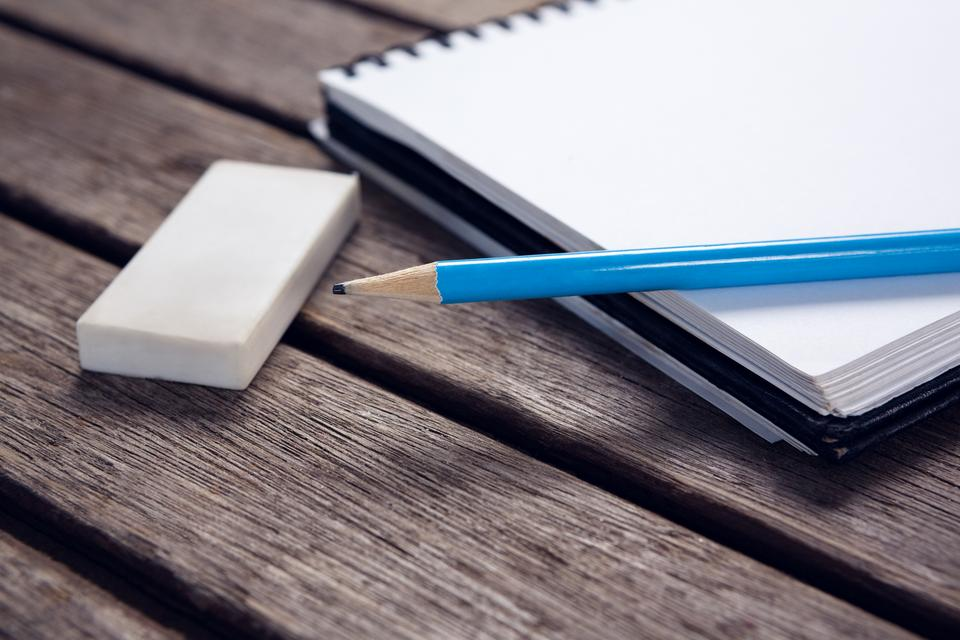 """""""Close-up of pencil and eraser on open diary"""" stock image"""