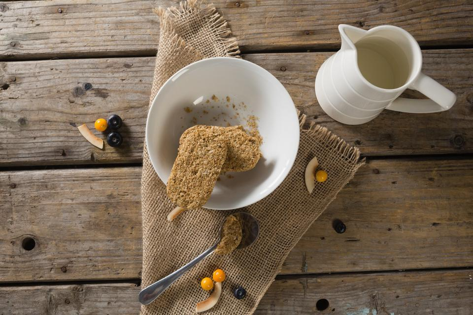 """""""Granola bar and milk on wooden table"""" stock image"""