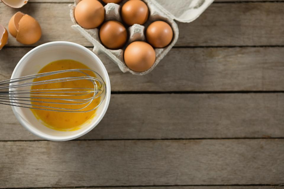 """Overhead view of eggs in bowl and carton"" stock image"