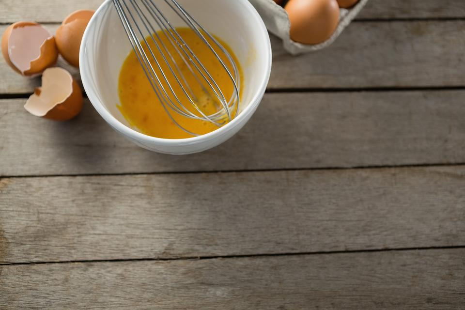"""Eggs in bowl and carton"" stock image"