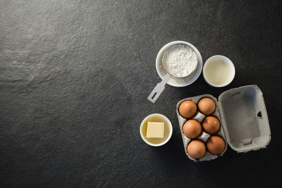 """Overhead view of ingredient by egg carton"" stock image"
