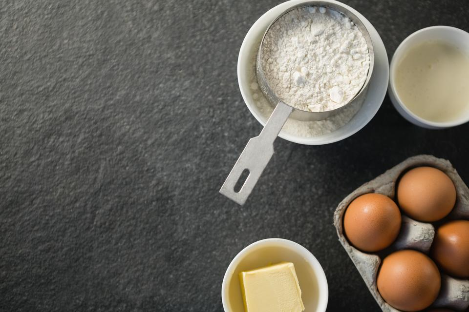 """Directly above shot of ingredient by egg carton"" stock image"