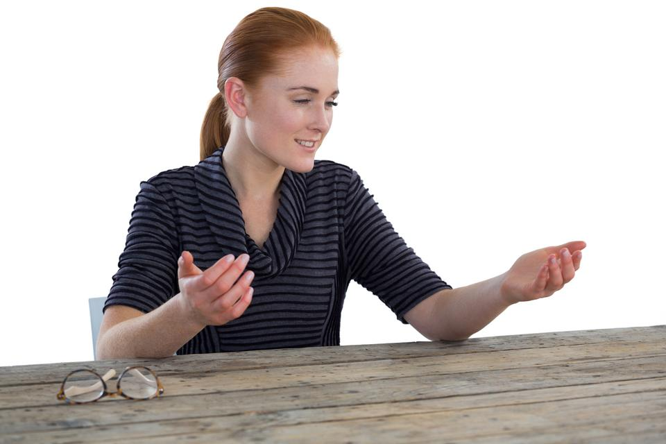 """Businesswoman holding imaginary product"" stock image"