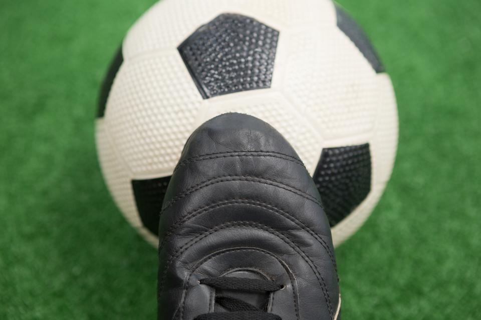 """""""Football and cleats on artificial grass"""" stock image"""