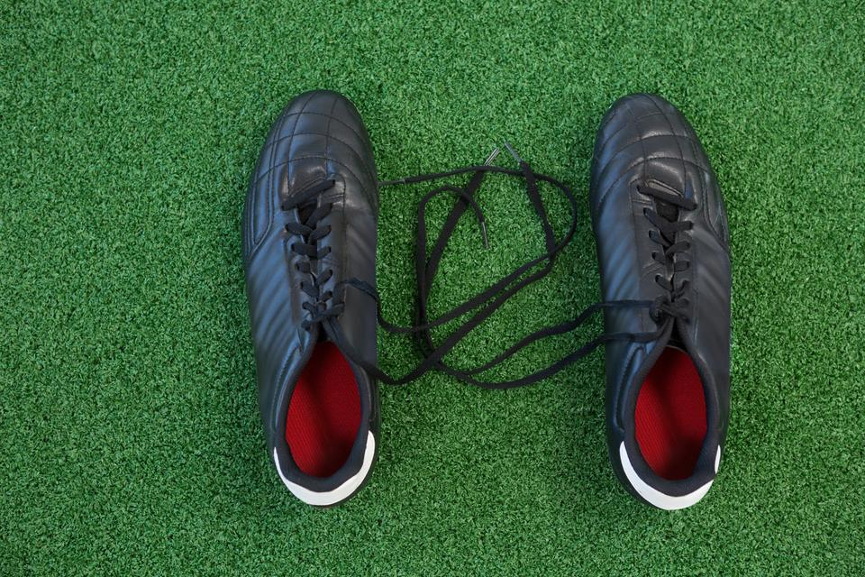 """""""Cleats on artificial grass"""" stock image"""