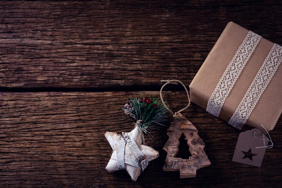 """Gift boxes and christmas decoration on wooden plank"" stock image"