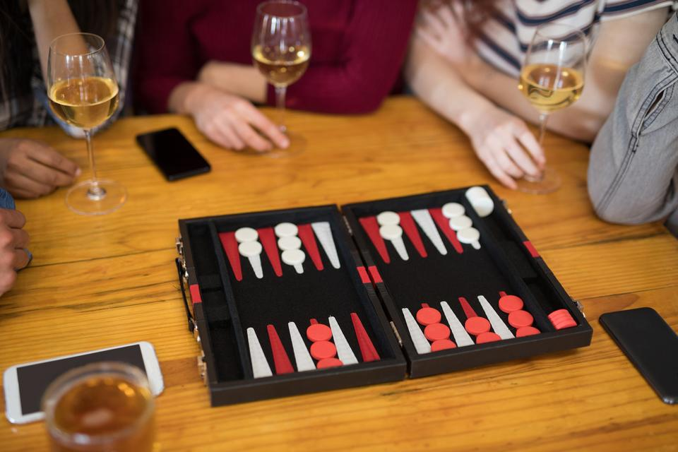 """""""Friends playing backgammon while having glass of wine"""" stock image"""