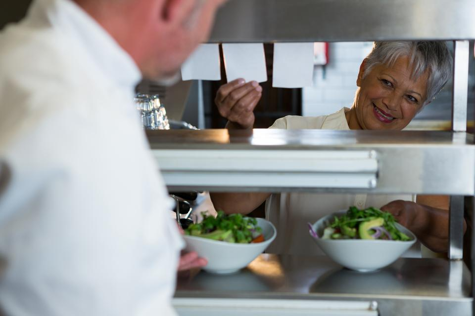 """""""Male and female chef interacting with each other"""" stock image"""