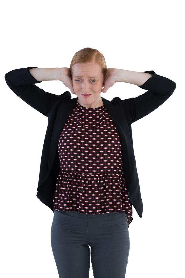 """""""Annoyed woman covering her ears"""" stock image"""