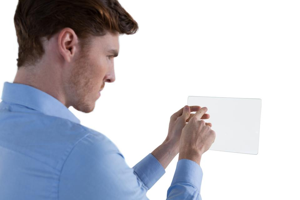 """""""Male executive using glass digital tablet"""" stock image"""