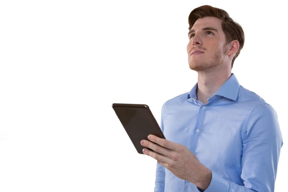 """""""Thoughtful male executive holding digital tablet"""" stock image"""