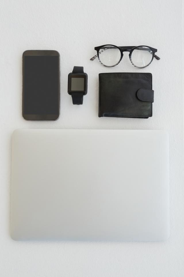 """""""Various gadgets, spectacles and wallet on white background"""" stock image"""