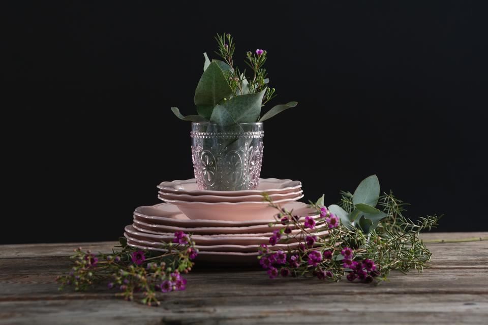 """""""Crockery and floral decorations on wooden plank"""" stock image"""