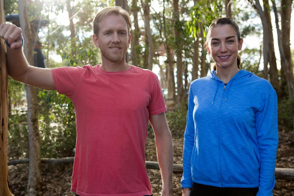 """Man and woman trainer standing together in forest"" stock image"