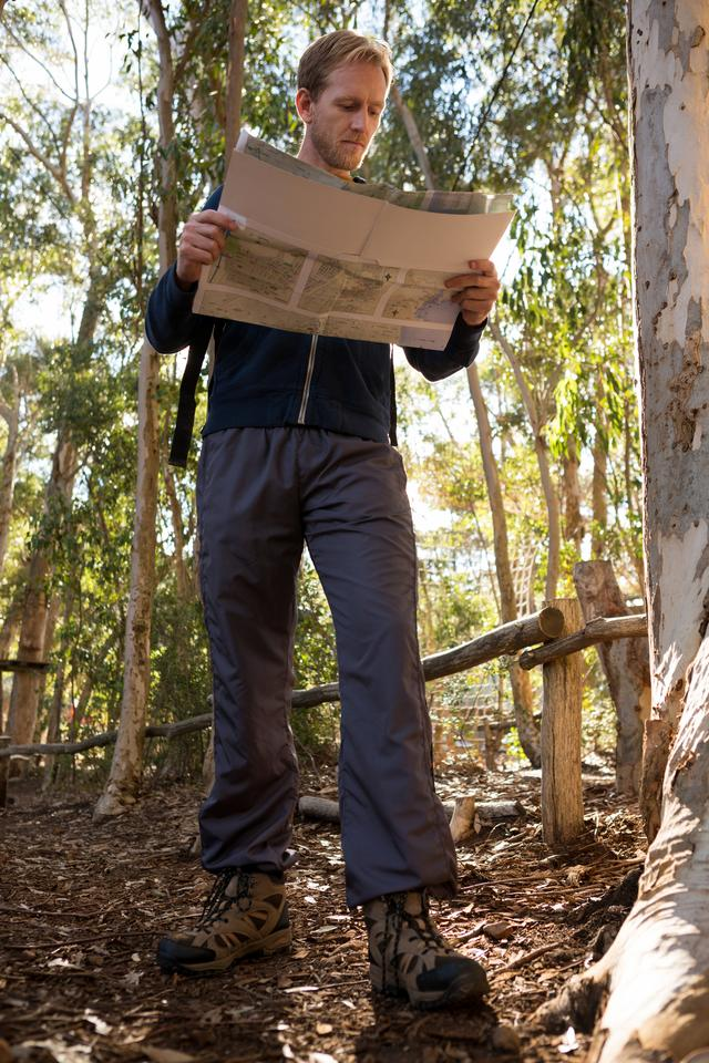 """Hiker reading a map on a sunny day"" stock image"