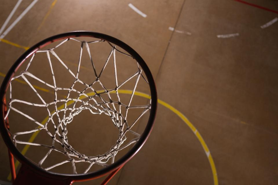 """Basketball hoop in the court"" stock image"