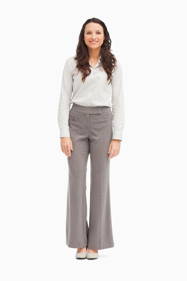 """Well dressed businesswoman standing"" stock image"