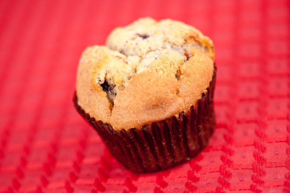 """Muffin on tablecloth"" stock image"
