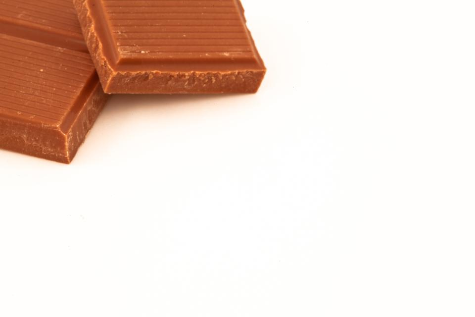 """""""Two pieces of milk chocolate"""" stock image"""