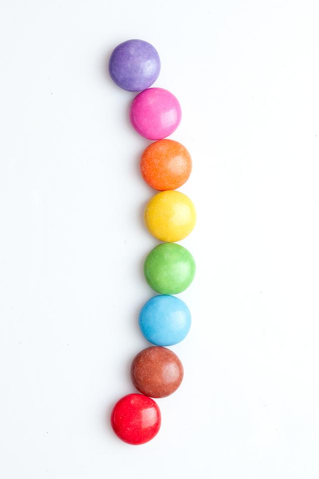 """""""Chocolate candies in a line"""" stock image"""