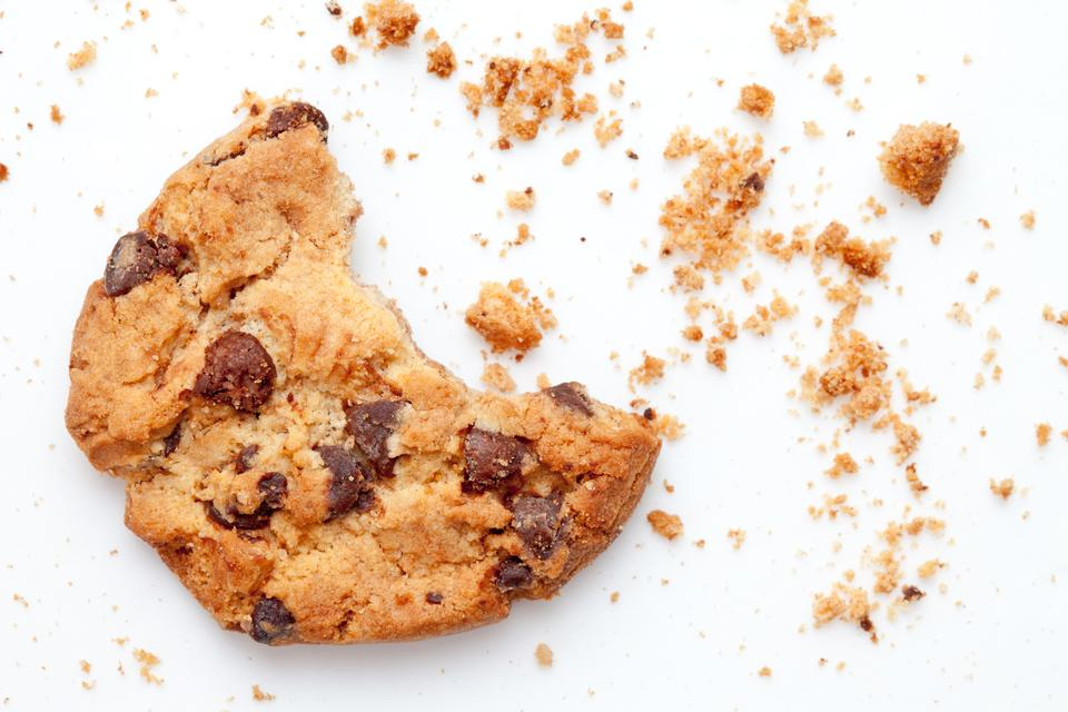 """Close up of an half eaten cookie with crumb"" stock image"