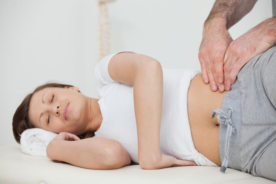 """""""Peaceful woman being massaged by her practitioner"""" stock image"""