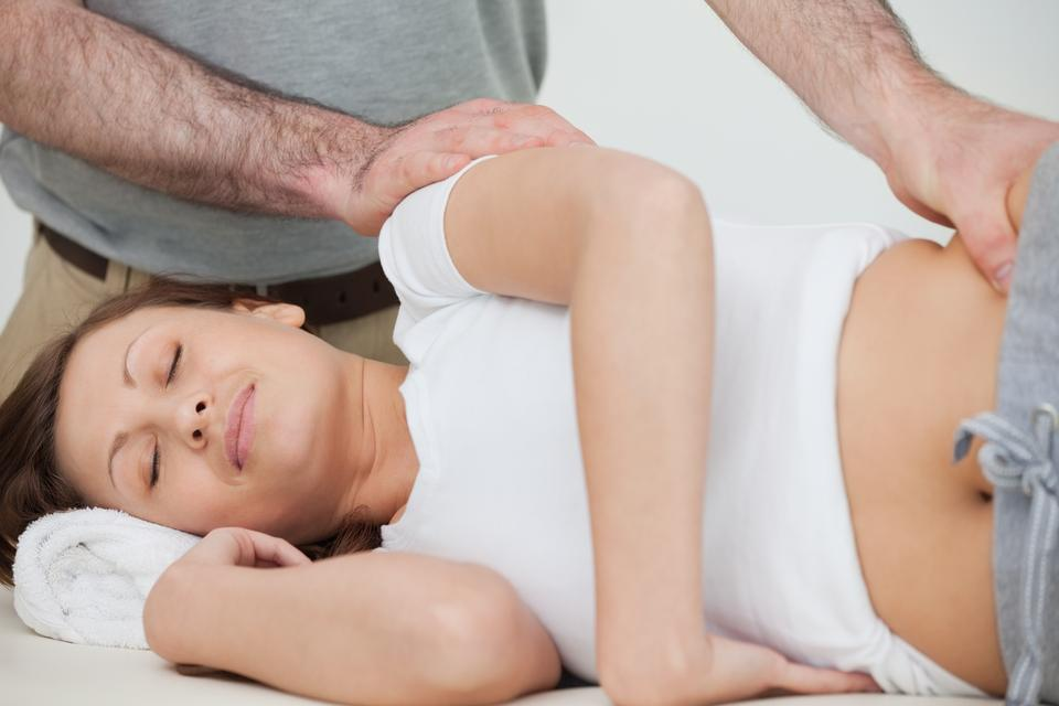 """""""Brunette woman being massaged by her osteopath"""" stock image"""