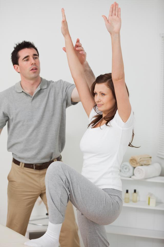 """""""Woman standing while doing her exercises"""" stock image"""