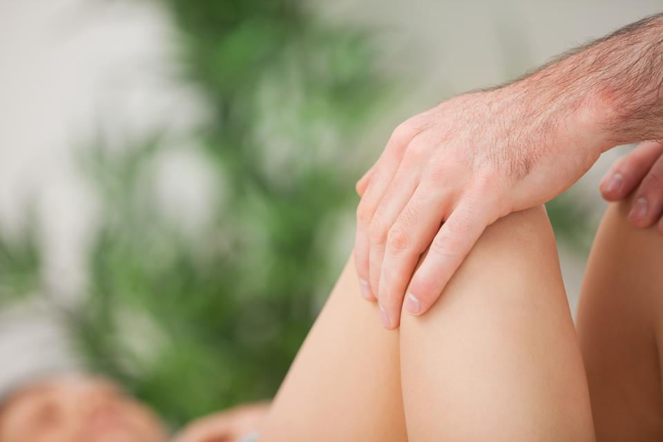 """""""Legs being held by a practitioner"""" stock image"""