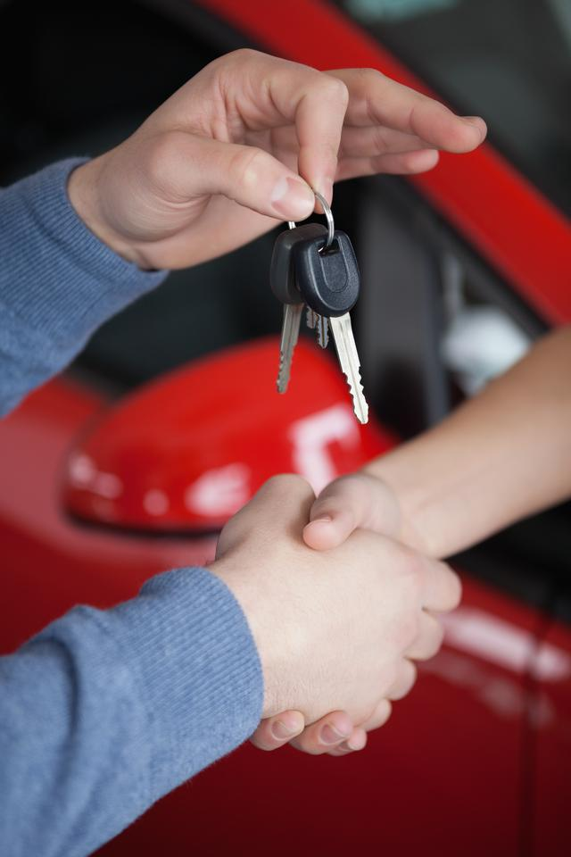 """""""Hands shaking and keys being hold"""" stock image"""