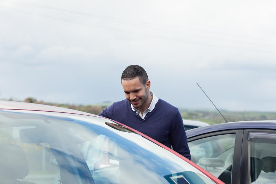 """""""Buyer looking inside a car"""" stock image"""