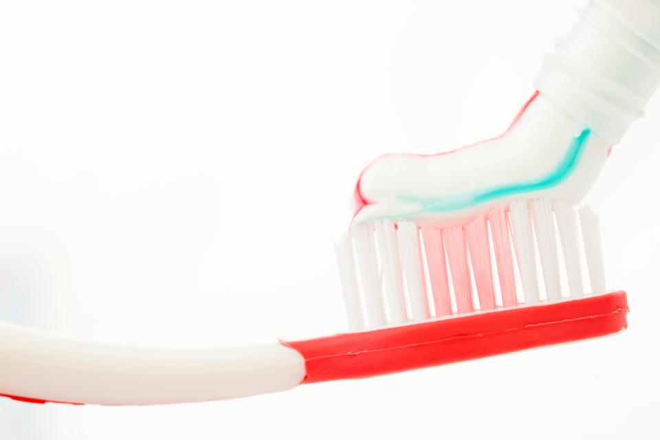 """Red toothbrush with multicolour toothpaste"" stock image"