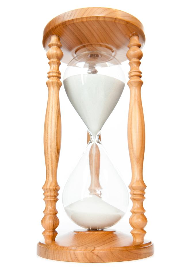 """Sand flowed of hourglass"" stock image"